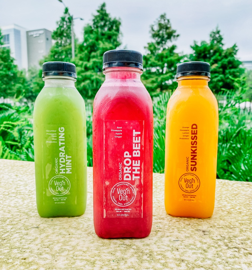 Three colorful cold-pressed juices at Veg'n Out